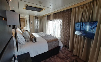 Norwegian Joy Haven Owner's Suite bedroom