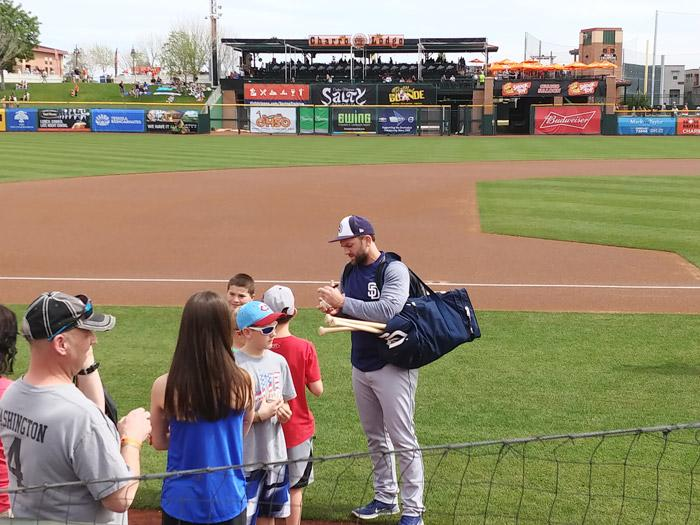 padres baseball player signing ball at scottsdale stadium spring training 2018