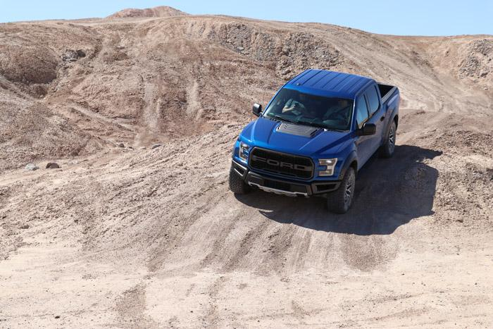 ford raptor on dirt trail