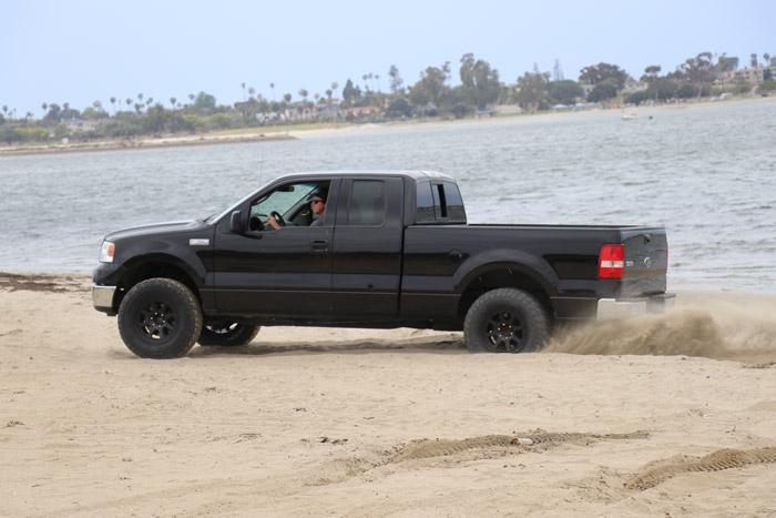f 150 with general tire at x in sand at the beach