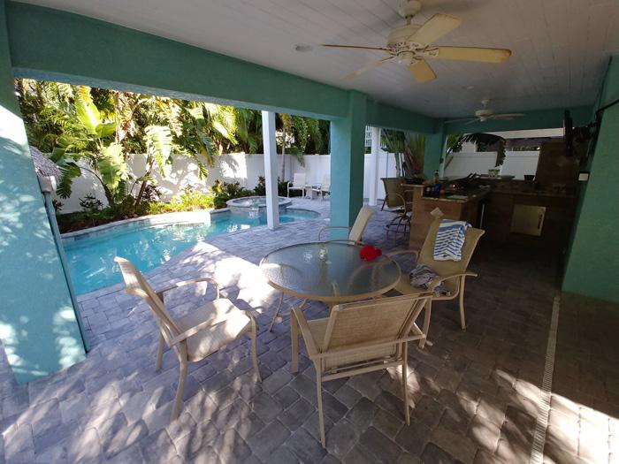 outdoor kitchen and pool area beachy villa vista vacation rental anna maria island florida