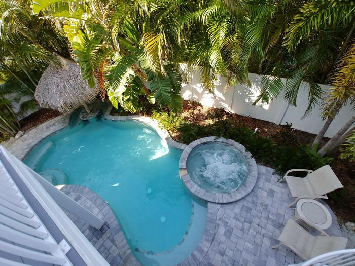pool and swim up tiki bar table beachy villa vista anna maria island vacation rental property