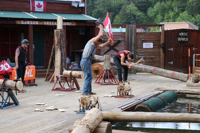chopping wood at great alaskan lumberjack show ketchikan alaska