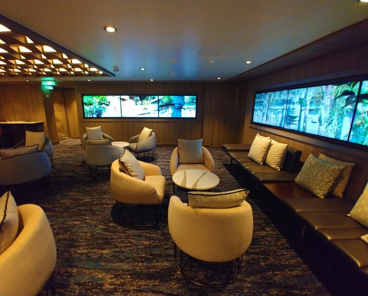 norwegian cruise line studio lounge for solo cruisers on ncl encore seating area