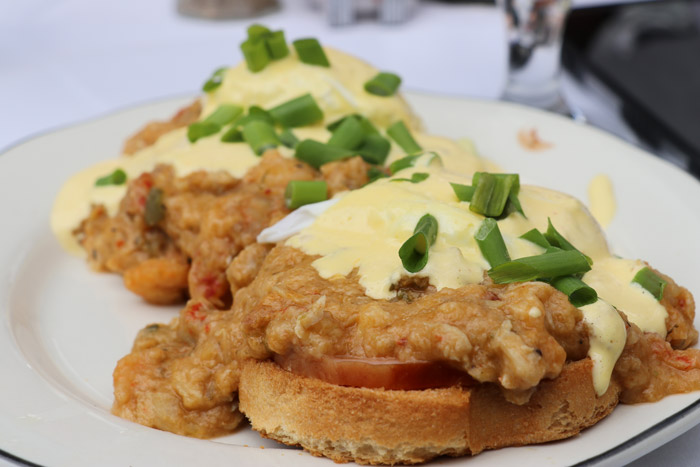 seafood eggs benedict at Court of Two Sisters restaurant in New Orleans Louisiana