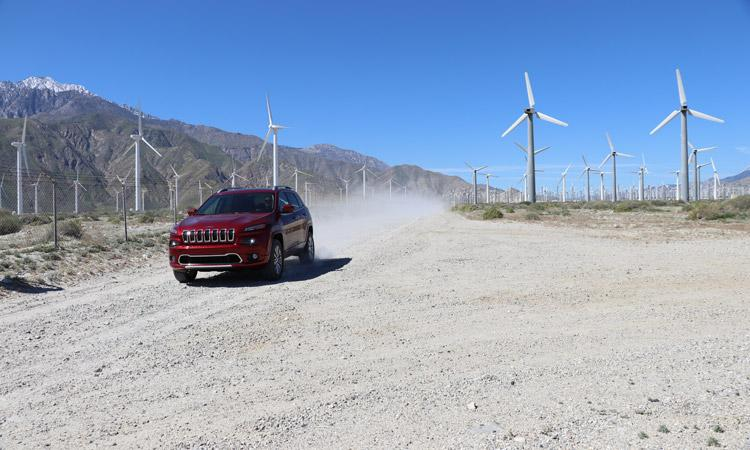 jeep cherokee driving past windmills in palm springs