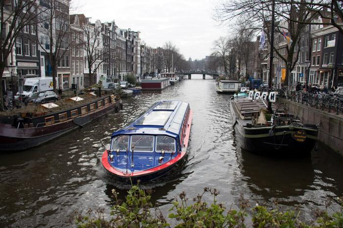 touring canals in amsterdam