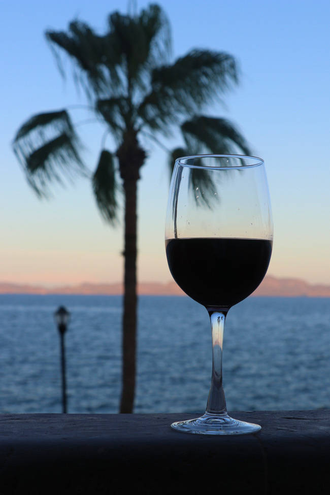 wine glass at sunset at la mision hotel loreto mexico