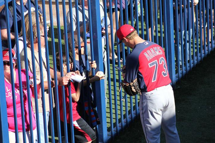 indians player signing autographs