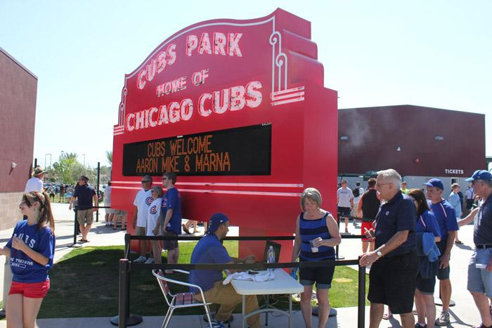photos in front of Cubs Park - Wrigley Field sign in Mesa Arizona