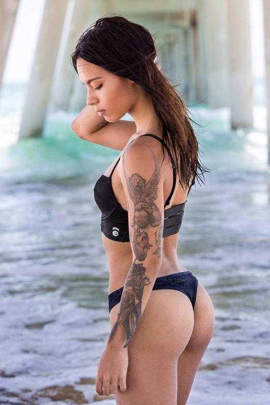 tattoo swimsuit girl under pier