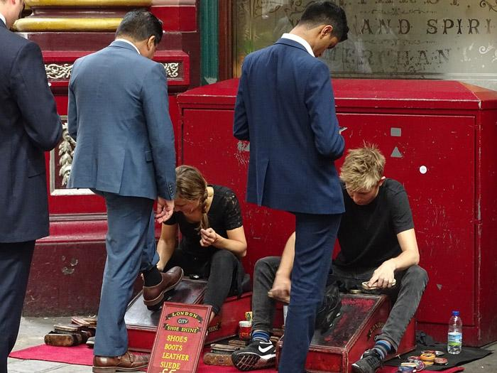 businessmen in london getting shoe shine