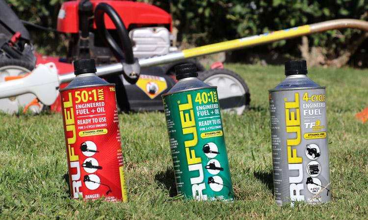trufuel cans in front of trimmer mower