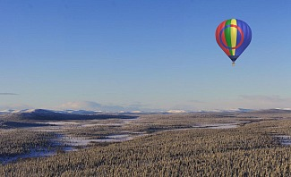 Take a hot air balloon over Lapland Sweeden in search of the Northern Lights